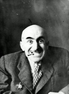 """With a cigarette"", a comic photo of Mikhail Verzhbinsky, grinning and with a cigarette"