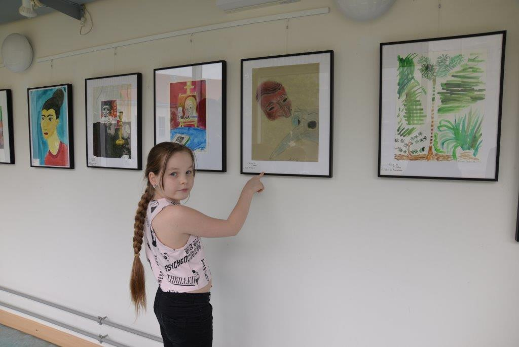 Young painter is showing her drawings